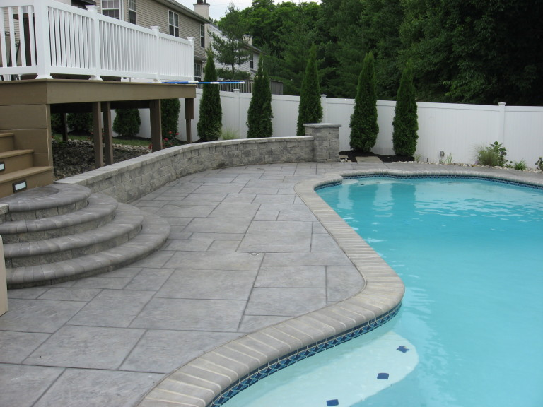 Why Choose Decorative Concrete Pavers For Your Pool?